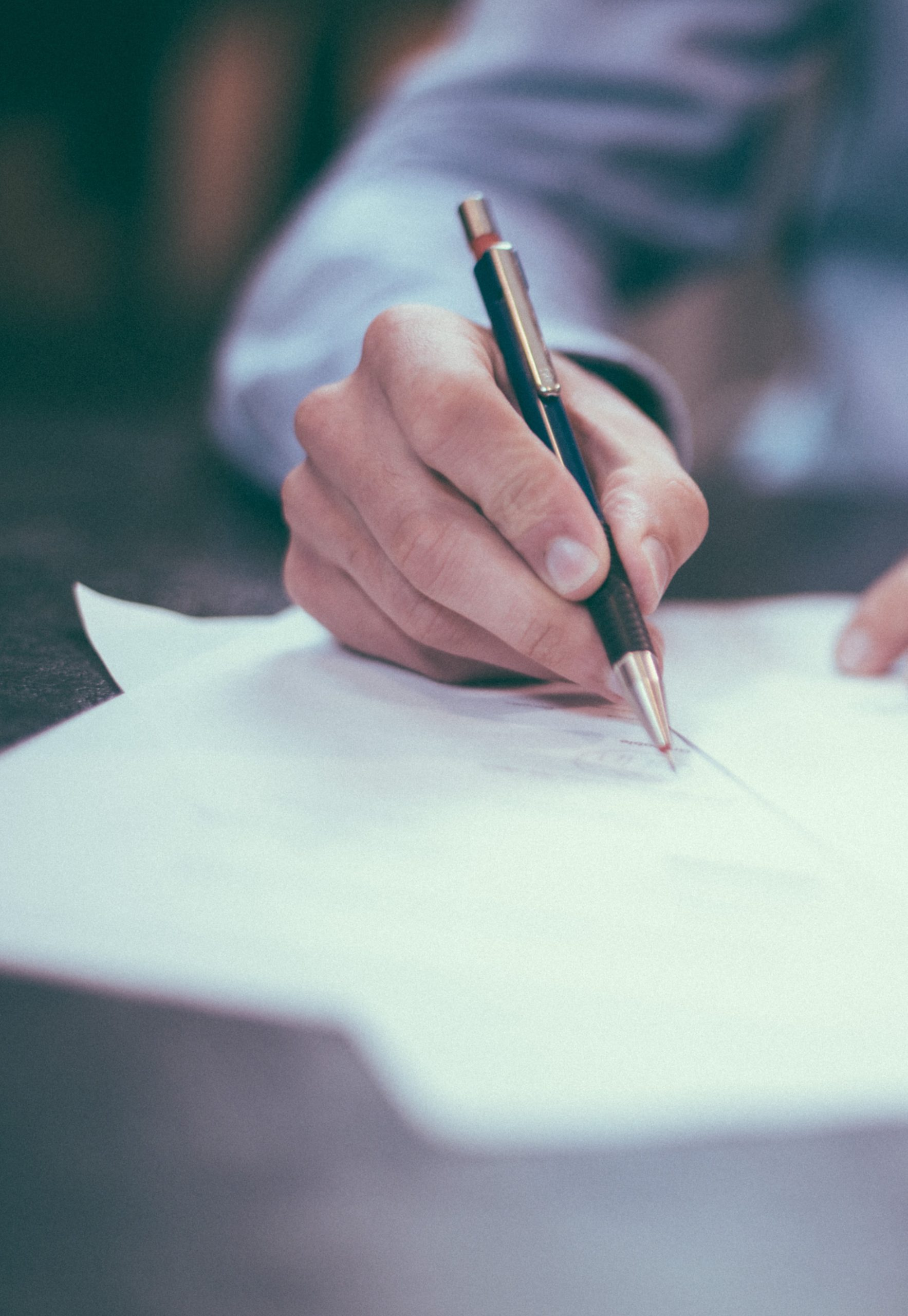 legal documents being signed when selling a business